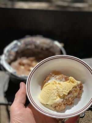 Bowl of Apple Spice Cobbler with Ice Cream.